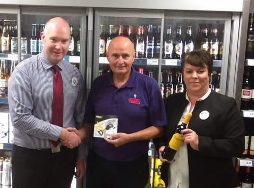 Team members receive special recognition from Tesco